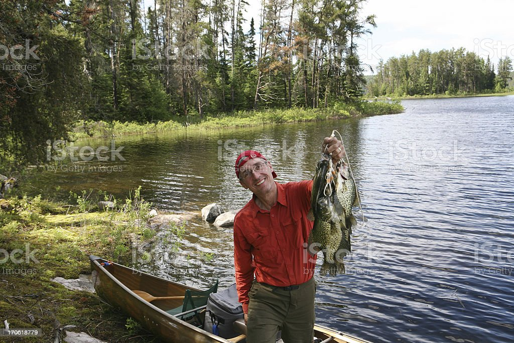 Fisherman with Stringer of Huge Crappies stock photo