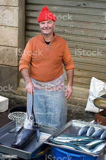 Fisherman With Swordfish On Fish Market Catania Sicily Stock Photo - Download Image Now