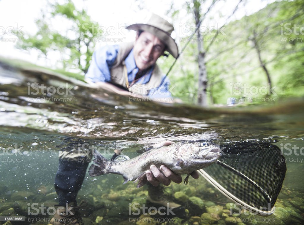 Fisherman with Trout stock photo