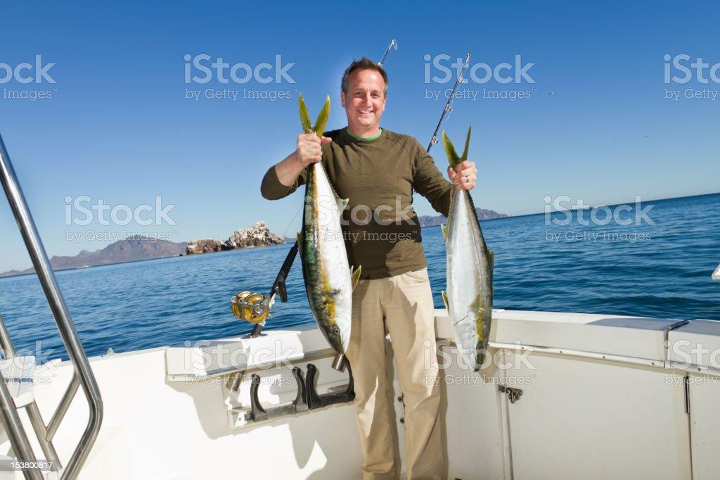 Pêcheur de thon ou poisson queue jaune Mackerel - Photo