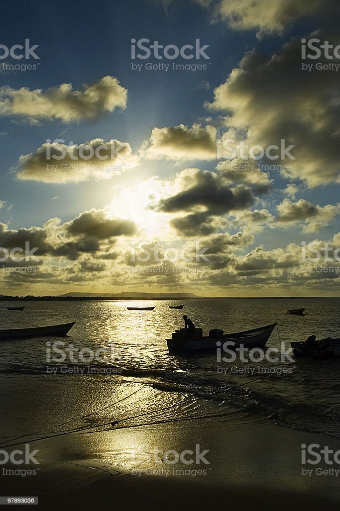 Fisherman working late afternoon royalty-free stock photo