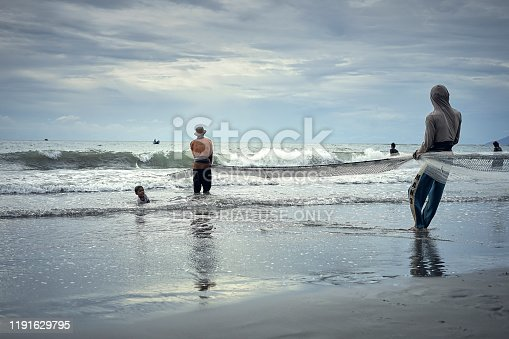 Banda Aceh, Indonesia -september 16, 2018 : Group of traditional fisherman working to catch the fish with trawl net at kampung jawa, Banda Aceh