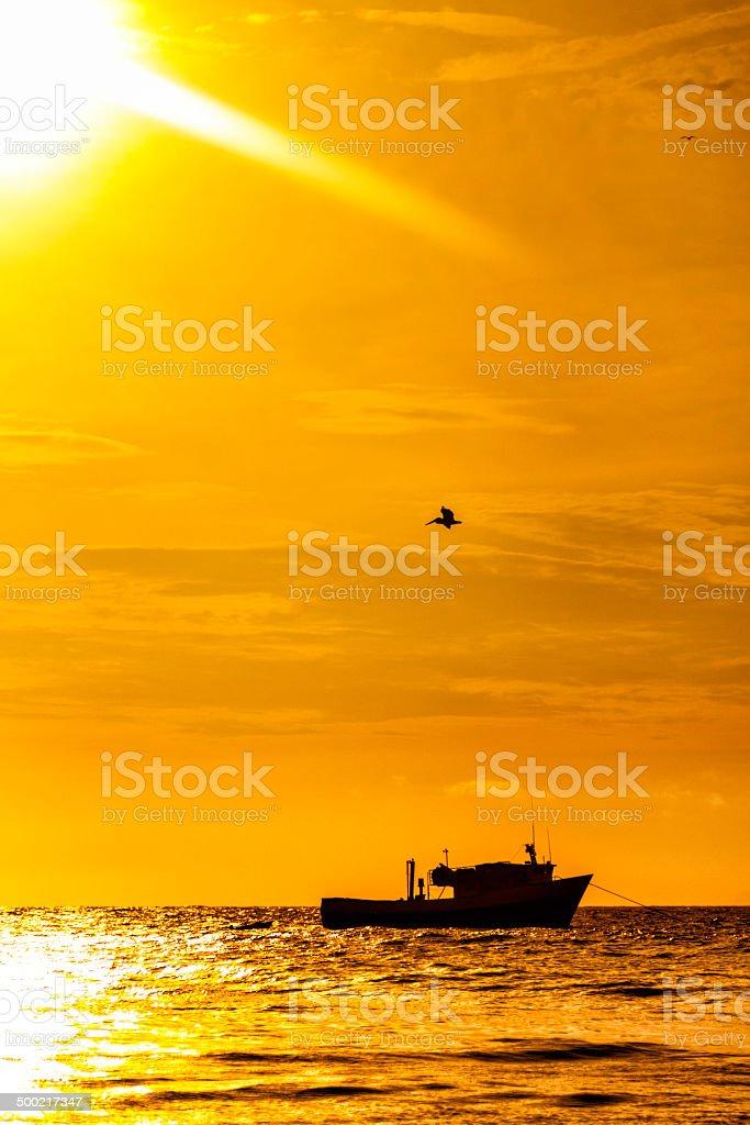 Fisherman's Boat anchored on Caribbean island at sunset royalty-free stock photo