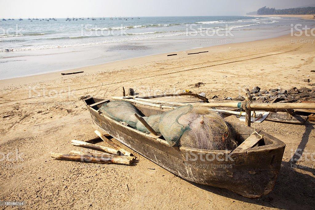 Fisherman's boat at coastline of Arabian Sea in India stock photo
