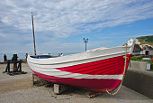 Fishing boats at the pebble beach of Yport, close to Etretat, Normandy, France
