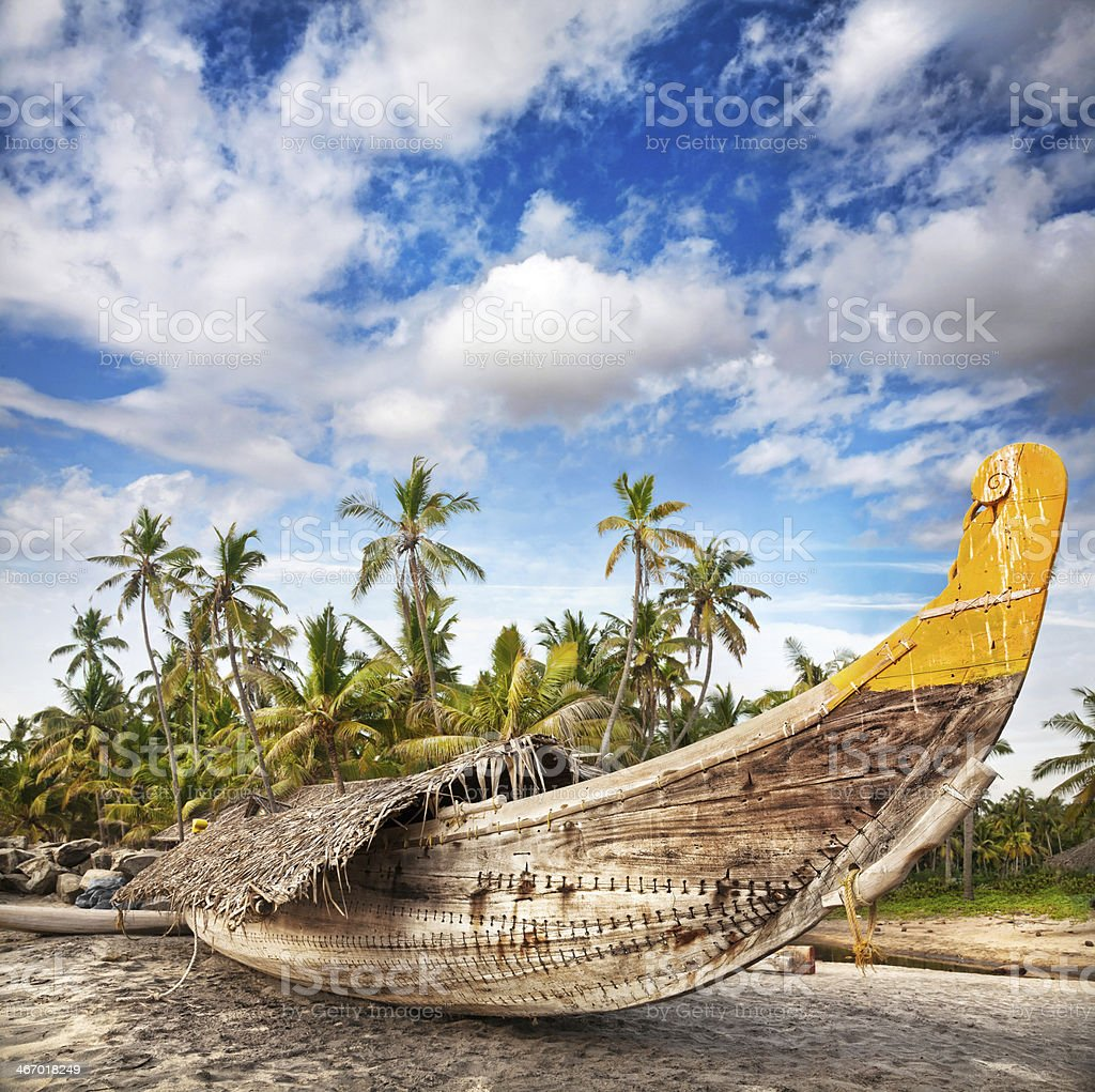 A fisherman's boat sat on a beach stock photo
