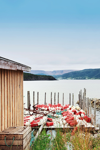 Fisherman's cottage with red-white buoys on the floor.