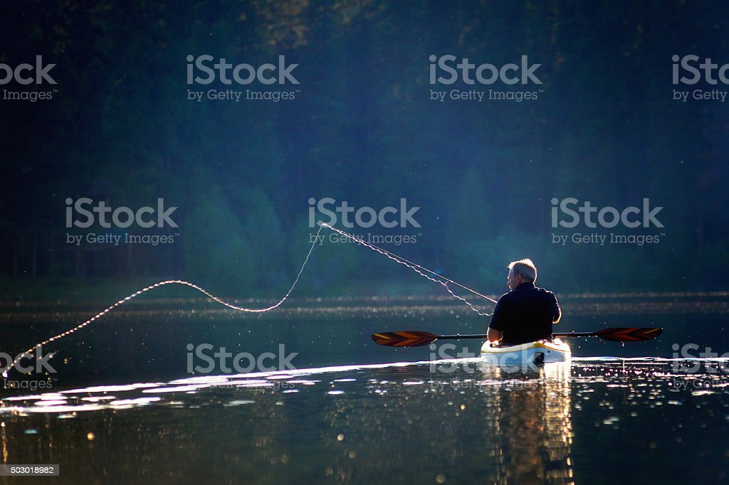 Fishermans Cast on a Sunny Afternoon stock photo