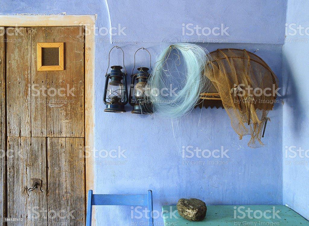 Fisherman's house entrance: net, fishing line, lanterns, Pantelleria, Italy stock photo