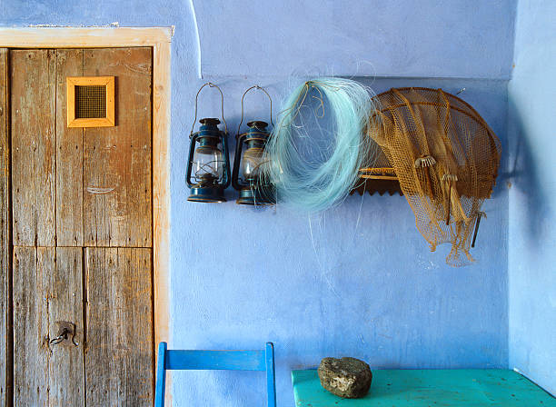 Fisherman's house entrance: net, fishing line, lanterns, Pantelleria, Italy stock photo