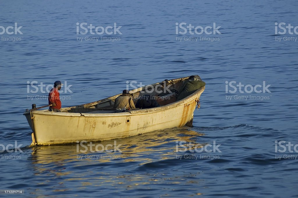Fishermans in a boat royalty-free stock photo