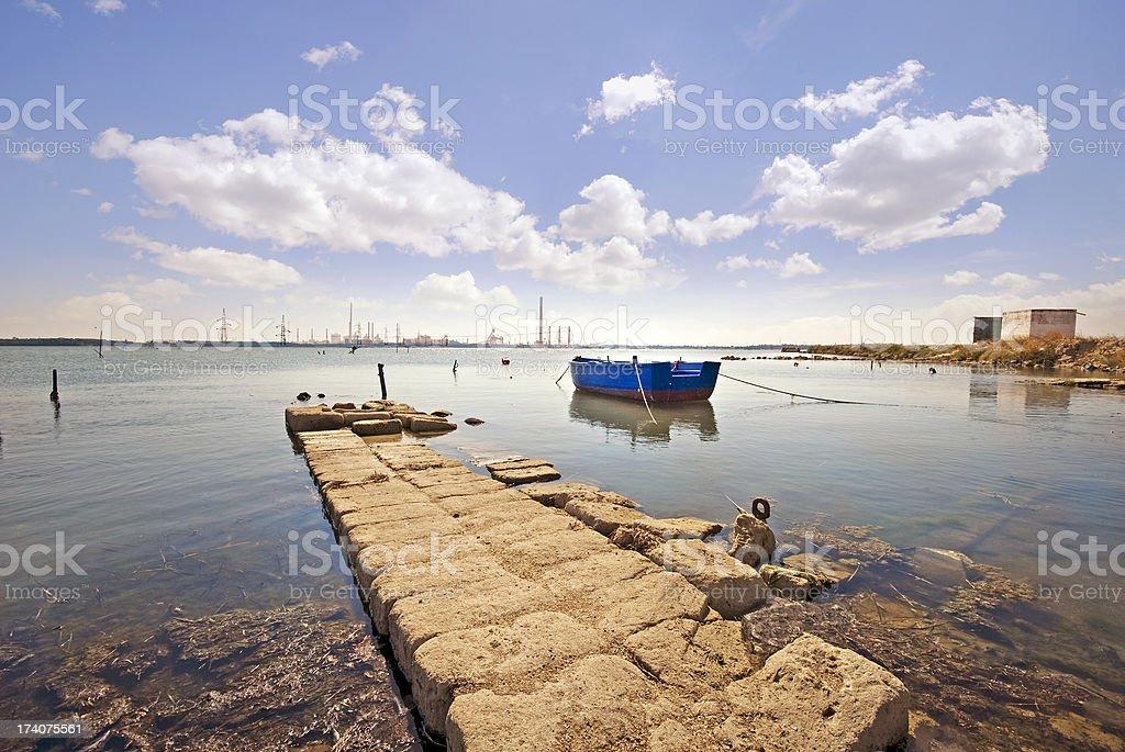 Fisherman's old Boat in Mar Piccolo, Taranto stock photo