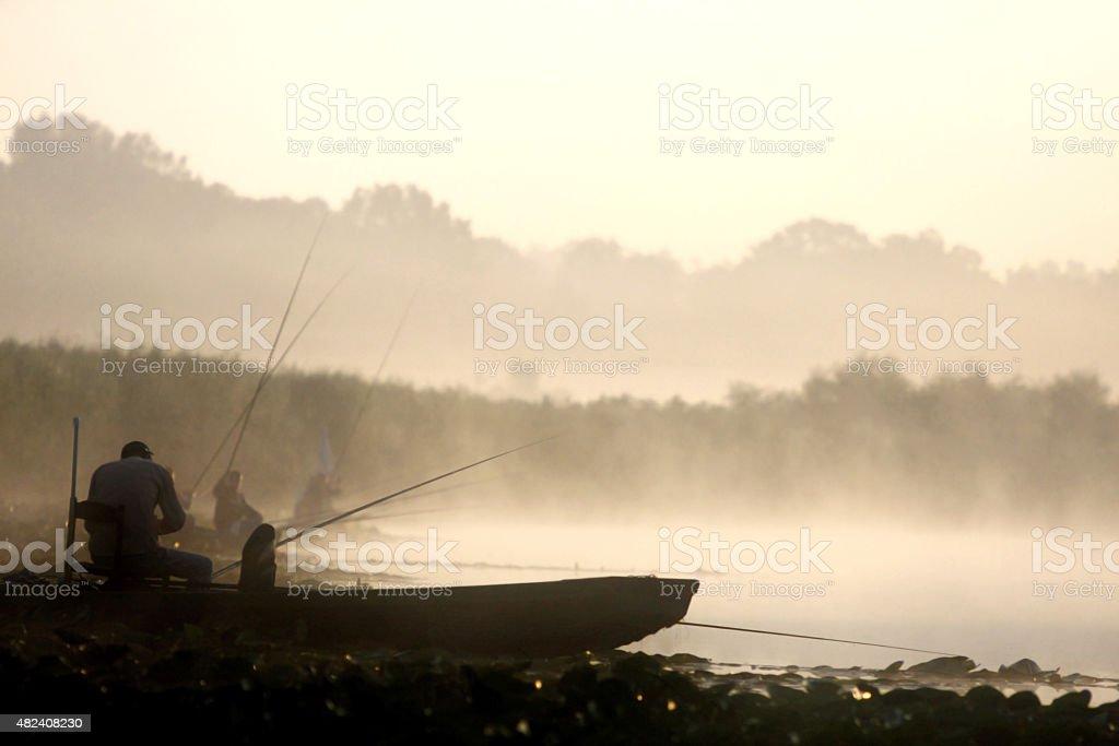 fishermans on boat stock photo