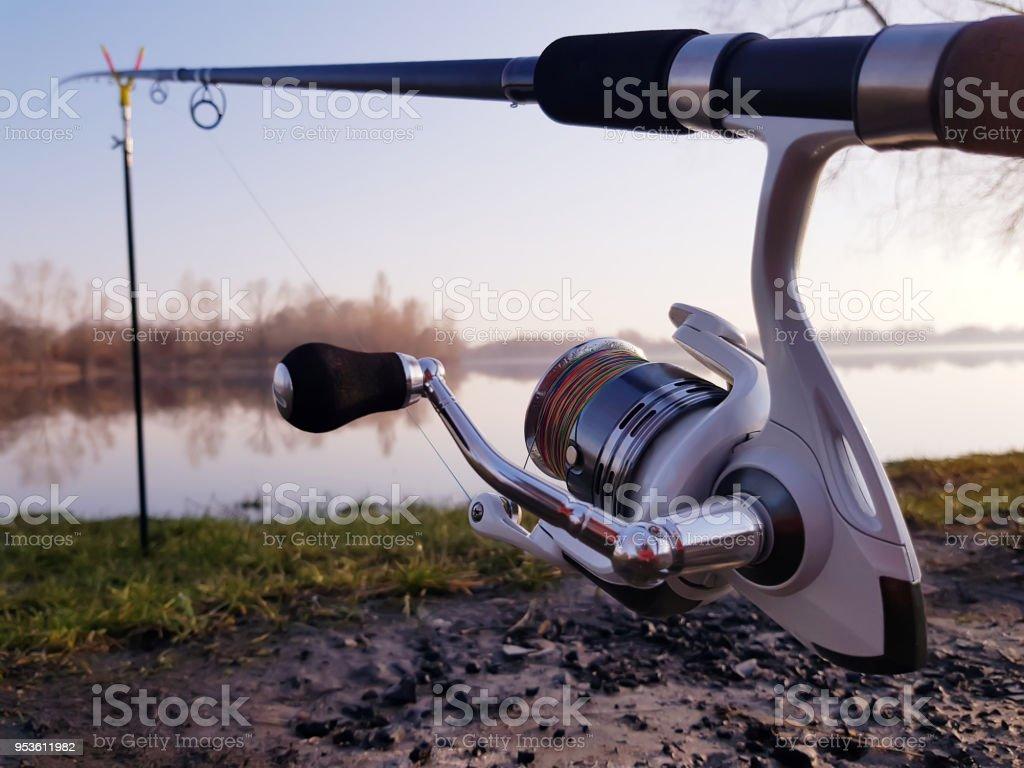 Fisherman's reel, mounted on a fishing rod. stock photo