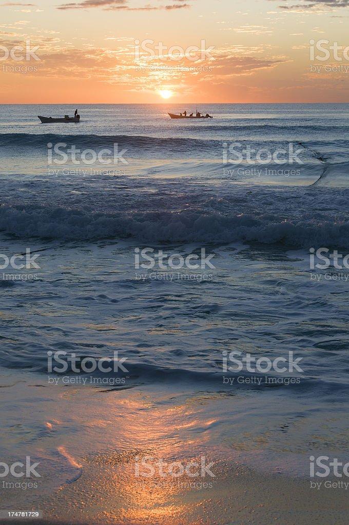 Fishermen at dawn stock photo