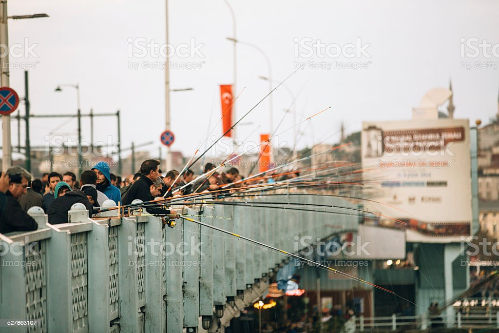 fishermen at galata bridge stock photo