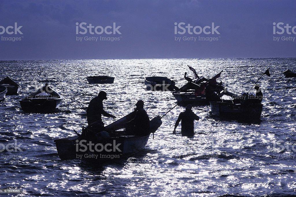 Fishermen at moonlight royalty-free stock photo