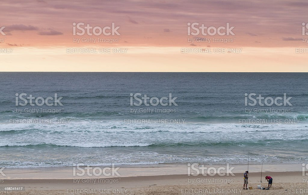 fishermen at sunrise stock photo