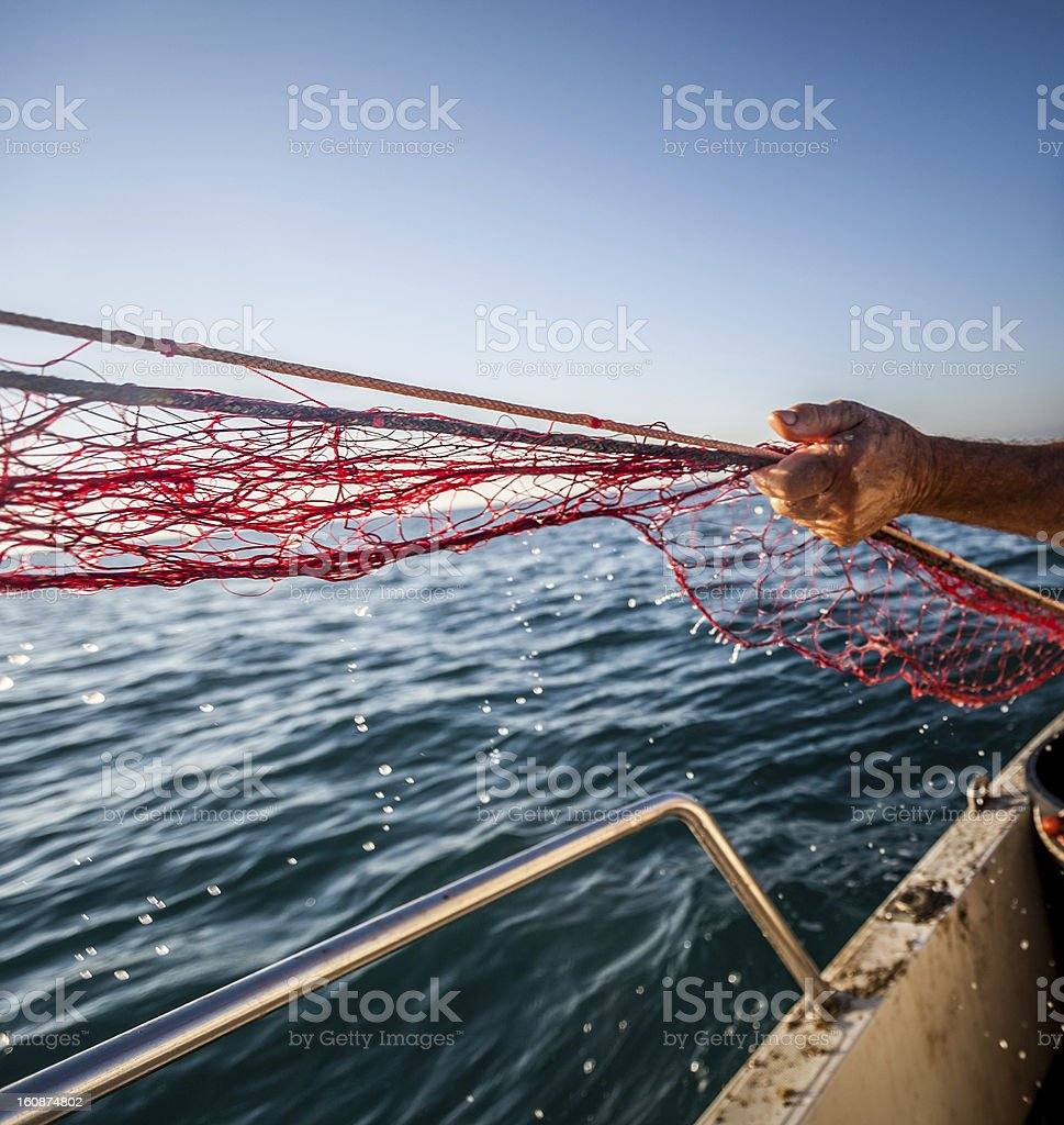 Fishermen at work, pulling the nets royalty-free stock photo