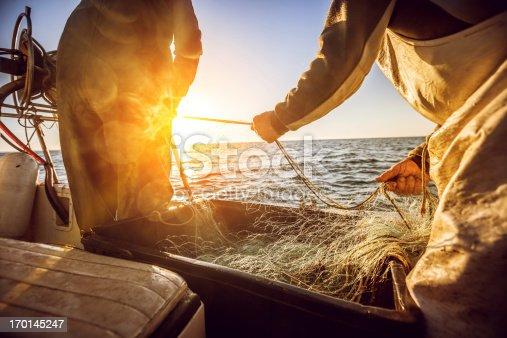 istock Fishermen at work, pulling the nets 170145247