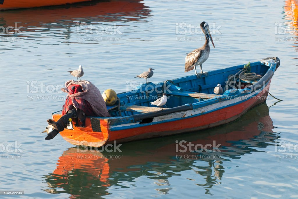 Fishermen boat in the coast of chile stock photo