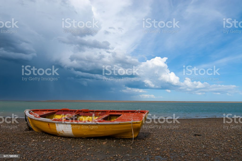 Fishermen boat in the coast of Patagonia stock photo