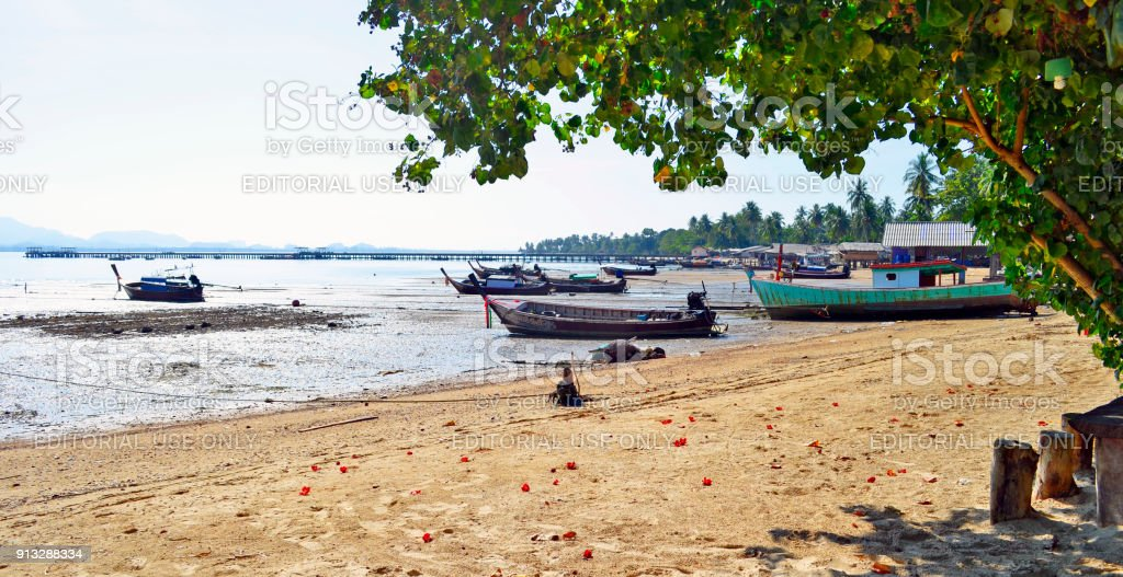 Fishermen boats and stilt houses at the North side of Haad Sivalai beach on Mook island stock photo