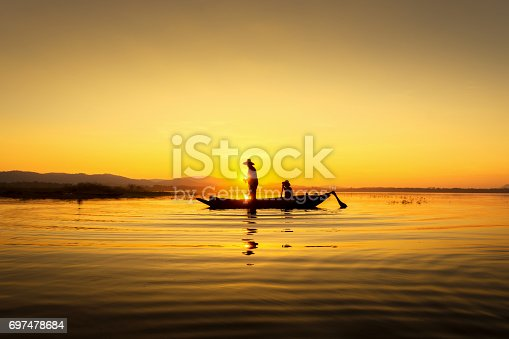 istock Fishermen can fish the golden morning light. 697478684