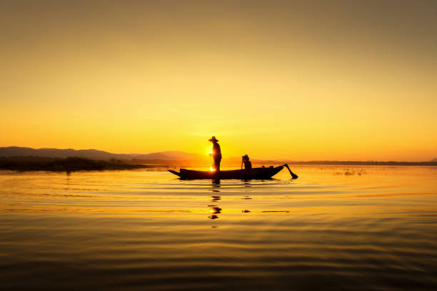 Fishermen can fish the golden morning light. stock photo