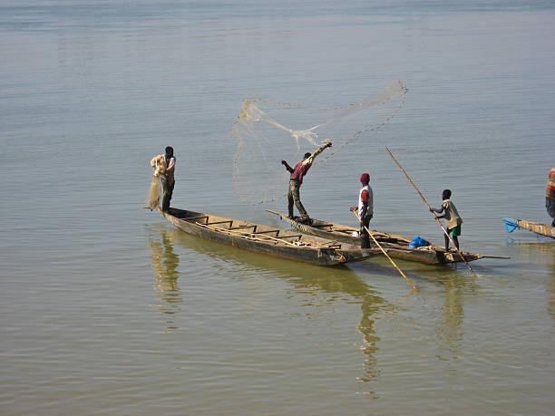 Fishermen cast a net on the Niger River, Mali stock photo