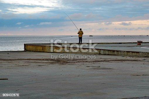 istock fishermen catch fish on the pier 909402876