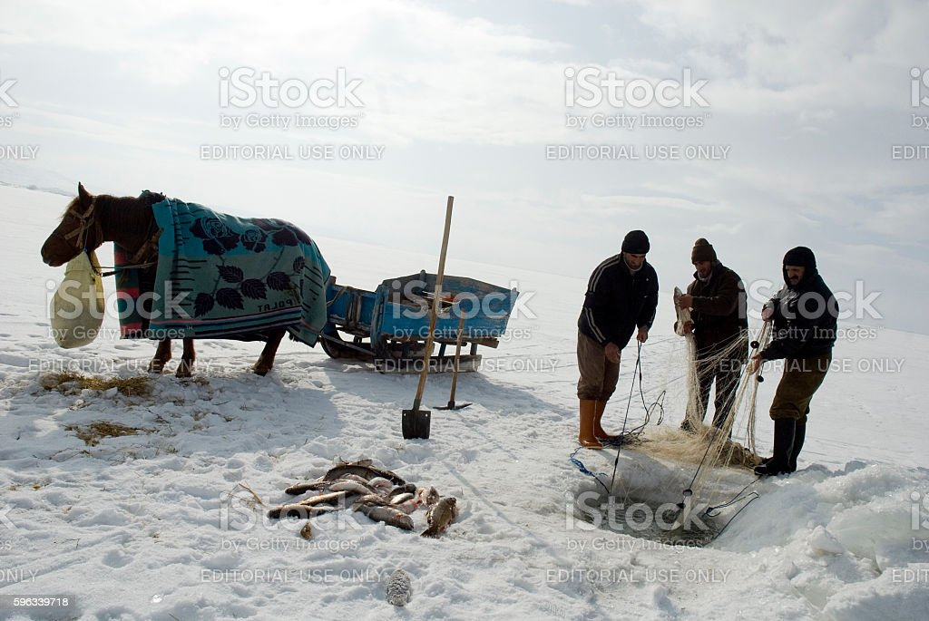 Fishermen catches fishes on Lake Cildir. stock photo