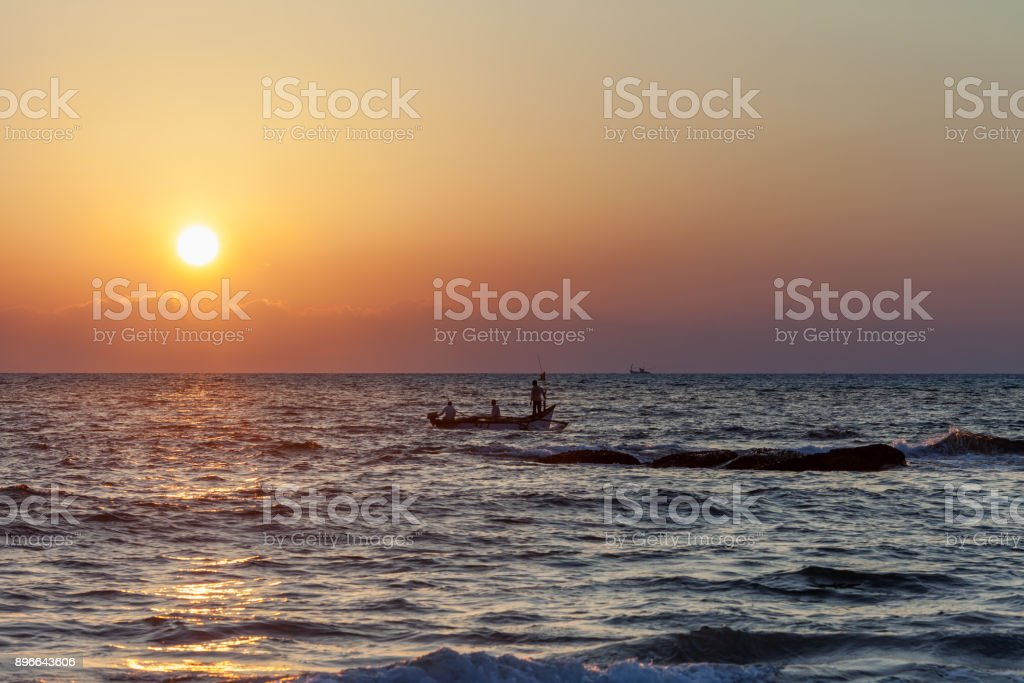 Fishermen come back from fishing stock photo
