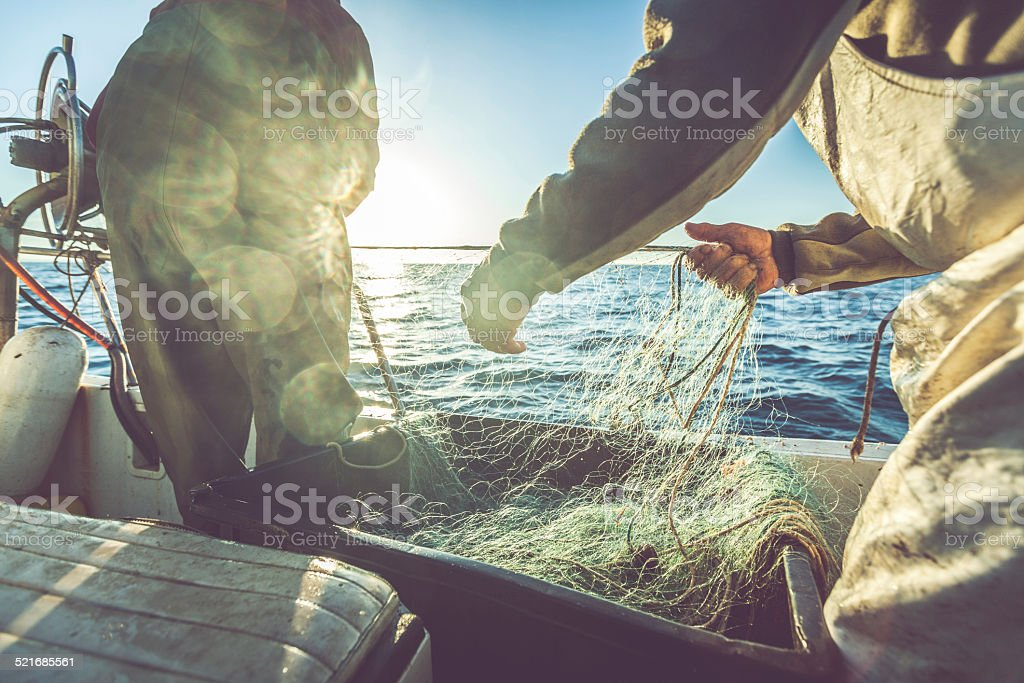 Fishermen hands stock photo