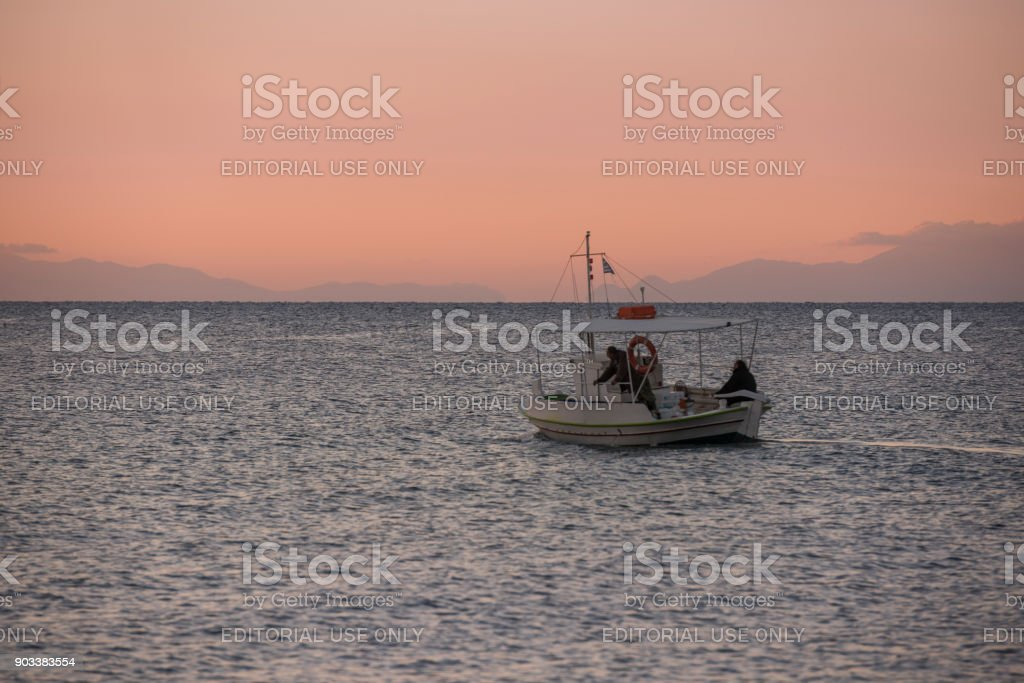 Fishermen heading to sea to collect last night's catch stock photo