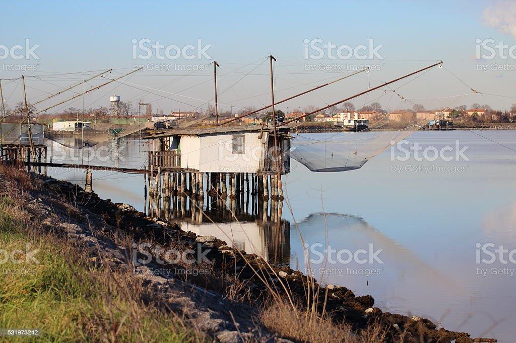 Fishermen huts in Lagoons stock photo