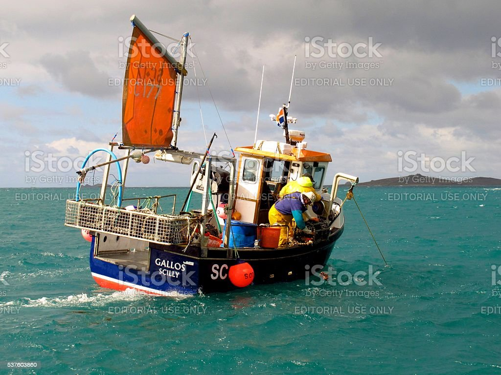 fishermen in fishing boat, Isles of Scilly, Cornwall, England stock photo