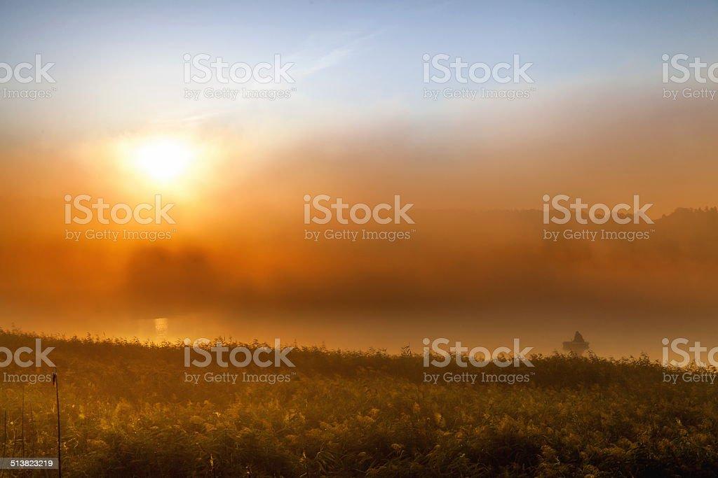 Fishermen in mist stock photo