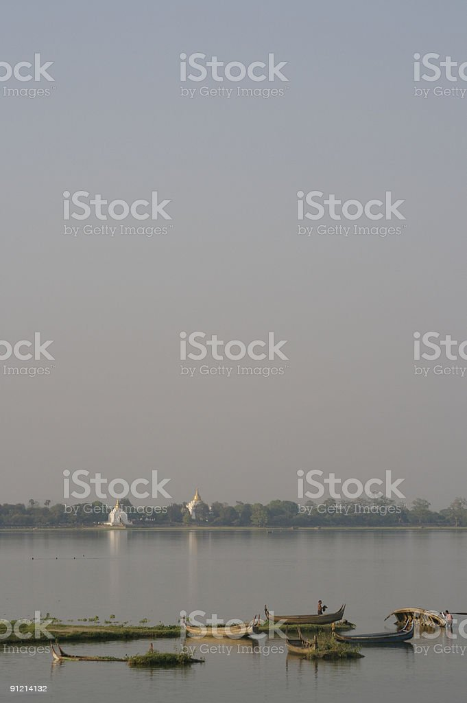 Fishermen in Taungthaman Lake stock photo