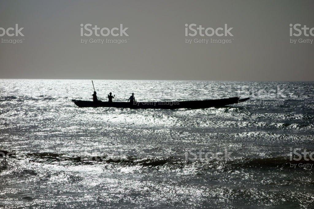 Fishermen in traditional pirogue, Toubab Dialao, Senegal stock photo