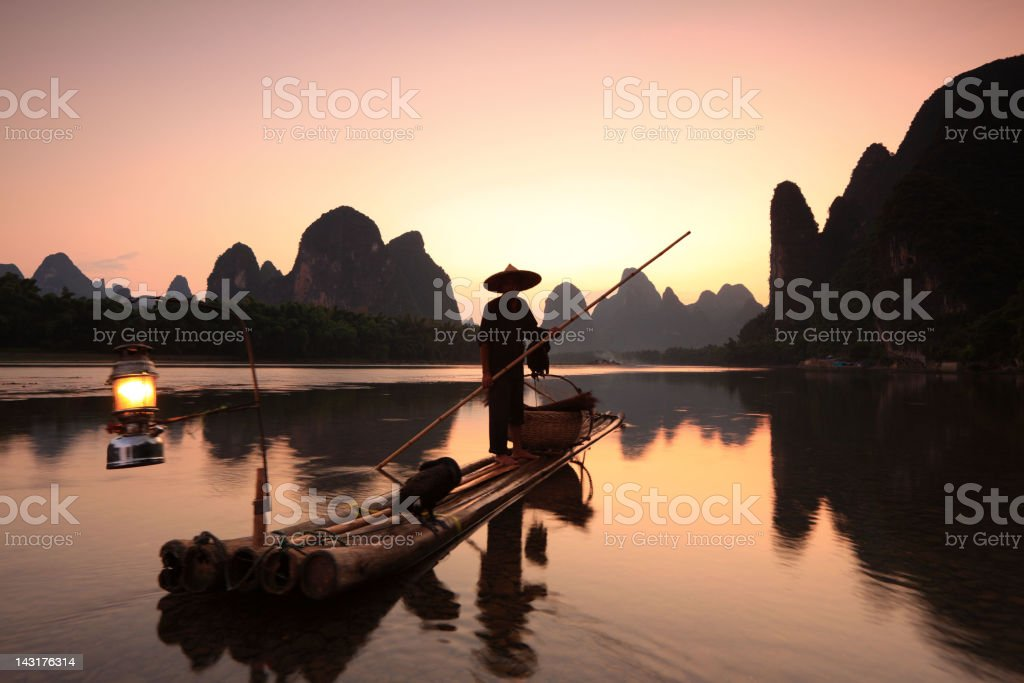 Fishermen on Li River stock photo