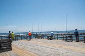 istock Fishermen on Pier at Myrtle Beach State Park 1280987588