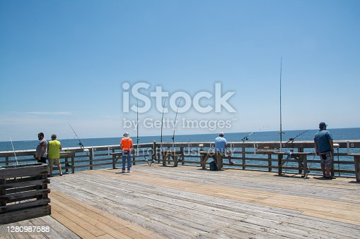 Myrtle Beach, United States - July 2nd, 2020: Fishermen on pier at the State Park in Myrtle Beach SC