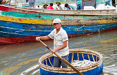Nghe An, Viet Nam - July 18, 2015: An unidentified fisherman worked in fishing village in Vietnam