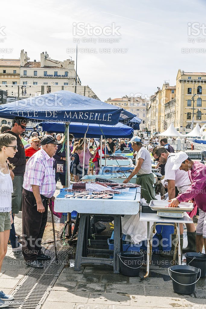 Fishermen sells fresh fish at Old Port of Marseille stock photo