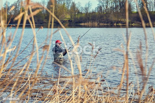 139888169istockphoto Fishermen spin fishing using chest waders to stay dry. 951984604