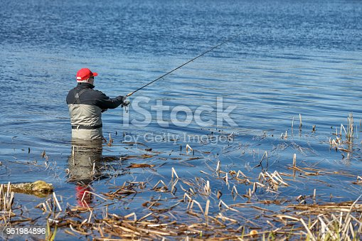 139888169istockphoto Fishermen spin fishing using chest waders to stay dry. 951984896