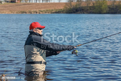 139888169istockphoto Fishermen spin fishing using chest waders to stay dry. 951984958
