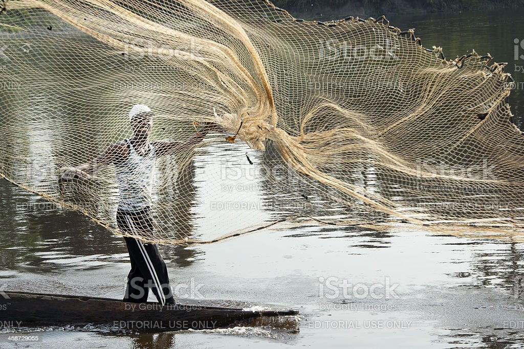 Fishermen throwing his net at  Congo River royalty-free stock photo