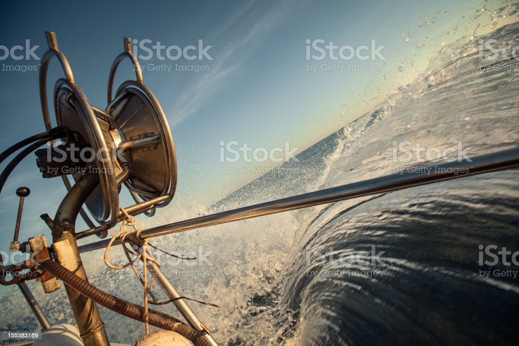 Fishermen Trawler Full Speed on Waves royalty-free stock photo